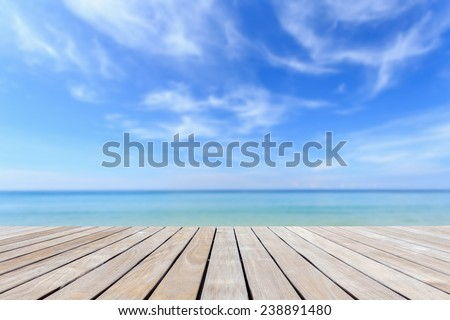 Grey wood decking and tropical beach - stock photo