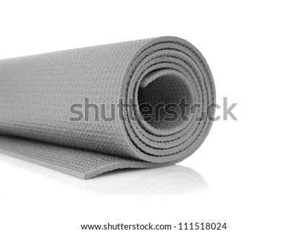 Grey yoga mat isolated on white background - stock photo