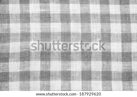 greys checked fabric tablecloth - stock photo