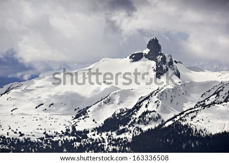 Gribaldi Peak in Gribaldi National Park, British Columbia, Canada, commonly referred to as Black Tusk as seen from Symphony Bowl, on Whistler Mountain. - stock photo