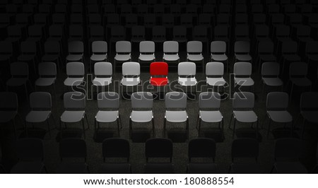 Grid of Chairs with a bright illuminated red Chair standing out