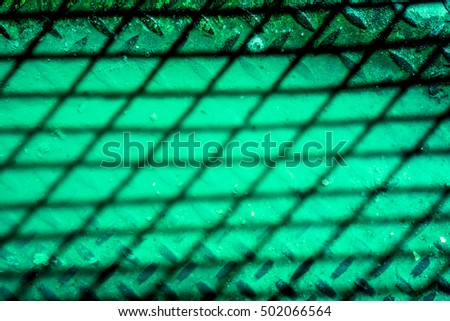 grid shadow on green background, shadow from netting against yellow, netting shadow as texture, high quality resolution