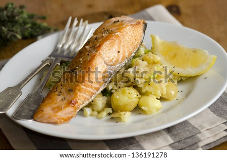 Griddled salmon on Parmesan potatoes