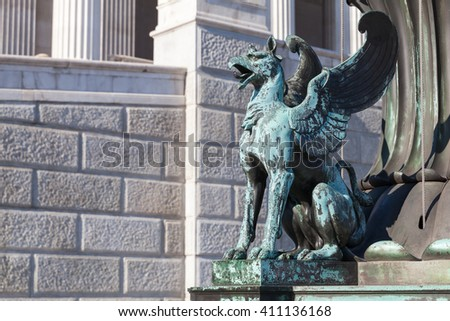 Griffin bronze statue. Decoration of old street lamp in front of Austrian Parliament Building, Vienna, Austria. It was erected in 1900. Selective focus