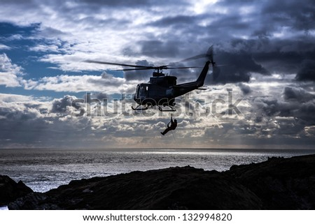 Griffin Helicopter hovering off the coast of the Isle of Anglesey North Wales
