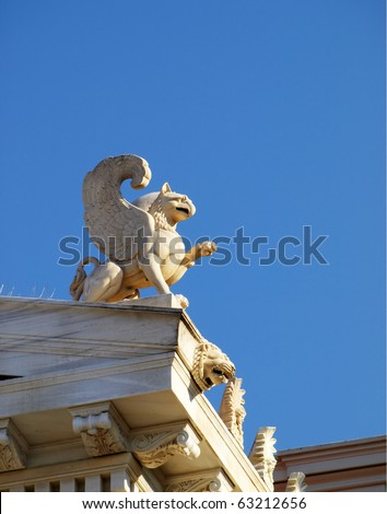 Griffin statue and lion head, detail of a Neoclassical building,  Zapeion Athens Greece - stock photo