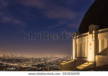 Griffith Observatory at night with Los Angeles city lights in the background - stock photo