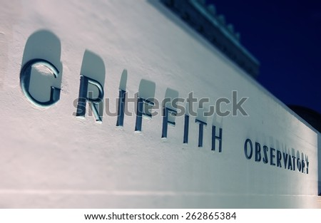 Griffith Observatory Wall Sign at Night. Los Angeles, California, United States. - stock photo