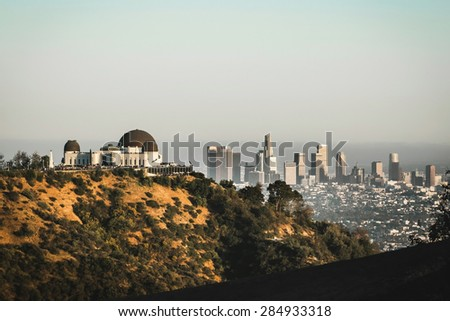 Griffith Observatory with a beautiful view on Los Angeles Downtown when the sunset, California - stock photo