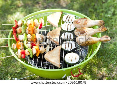 Grill bbq party with sausages,and vegetables  - stock photo