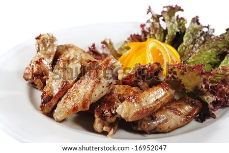 Grill Chicken on a Plate with Leaf of Salad and Slice Orange. Isolated over White