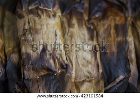 grill stick rice in dry banana leaf