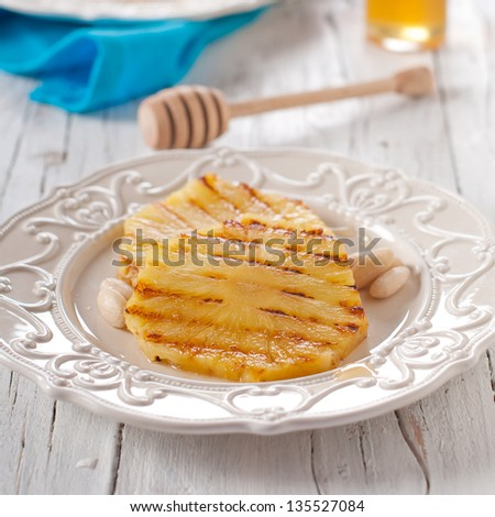 Grilled ananas with honey and almond, selective focus - stock photo