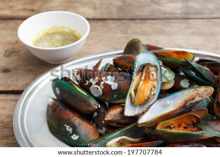 Grilled  asian green mussel with spicy seafood sauce