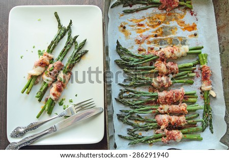 Grilled asparagus in bacon - stock photo