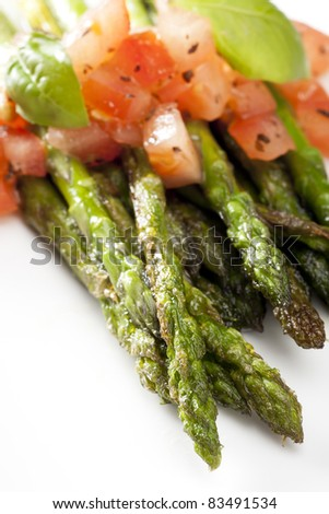 Grilled asparagus topped with a tomato and basil salsa - stock photo