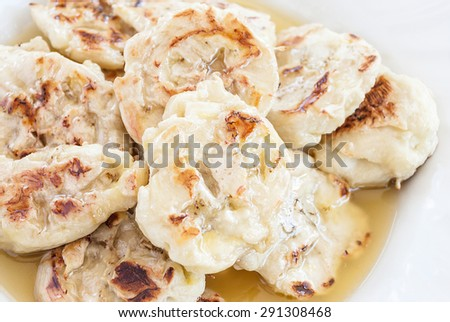 Grilled bananas with syrup, dessert in Thailand - stock photo