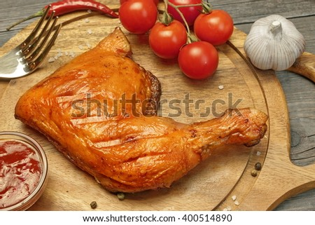 Grilled BBQ Crispy Chicken Leg Quarter On Wood Board, Top View, Closeup - stock photo