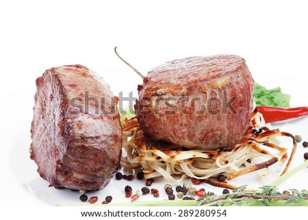 grilled beef fillet with thyme , red hot chili pepper and tomato on plate isolated over white background - stock photo