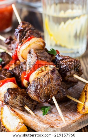 Grilled  beef shishkabab skewers  with vegetables - stock photo