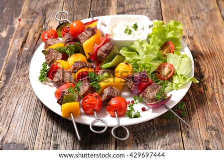 grilled beef skewer and salad - stock photo