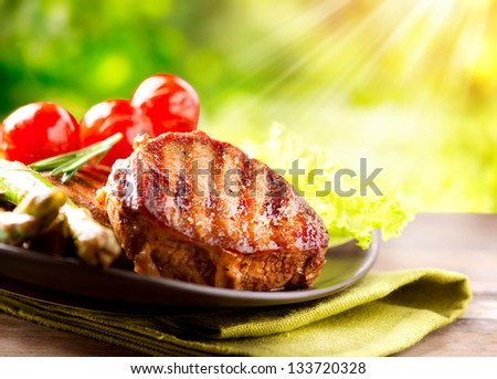 Grilled Beef Steak BBQ. Barbecue Meat Steak outdoor with Vegetables - stock photo