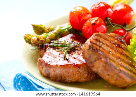 Grilled Beef Steak Meat with Fried Potato, Asparagus and Cherry Tomato. Steak Dinner. Food. BBQ Grill. Berbeque - stock photo