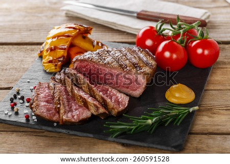 grilled beef steak rare sliced with vegetables - stock photo
