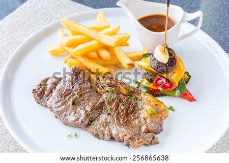 Grilled beef steak with french fried and baked vegetable - stock photo