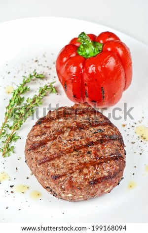 grilled beef steak with herbs and pepper - stock photo