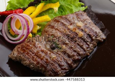 Grilled beef steak with onion and pepper
