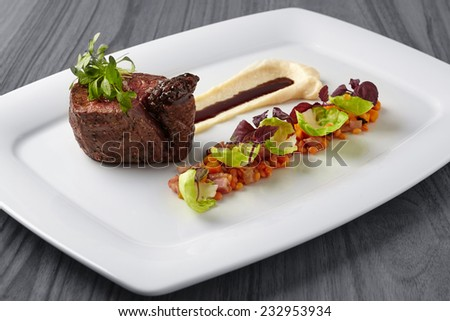 Grilled beef steak with potato puree and red lentils - stock photo