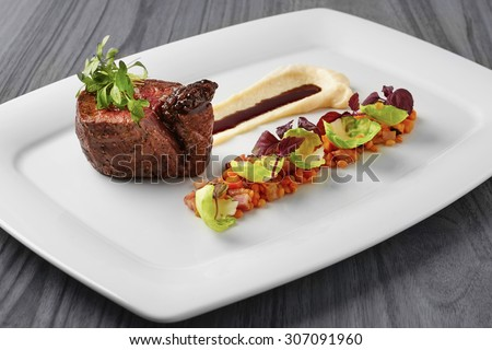 Grilled beef steak with potato puree and red lentils