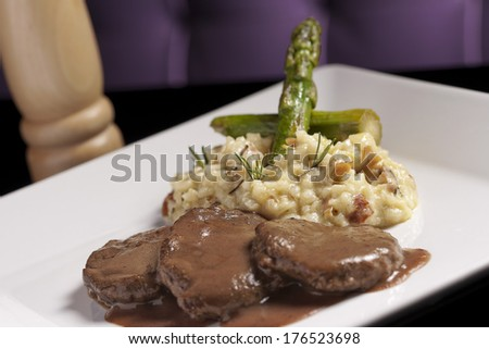 Grilled beef steak with Risotto, Asparagus and Rosemary - stock photo