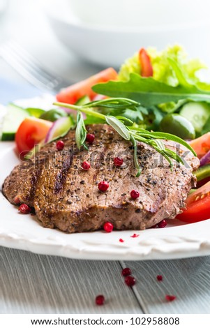 Grilled Beef Steak with Rosemary and Salad - stock photo
