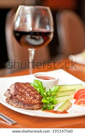 grilled beef steak with sauce and wine - stock photo