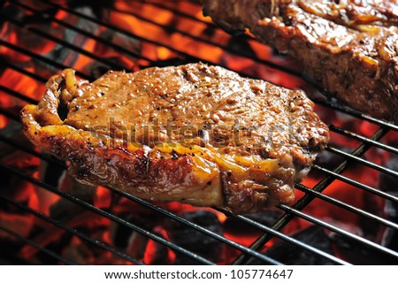Grilled beef steaks on the grill
