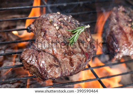 Grilled beef steaks on the grill. - stock photo