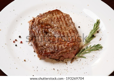 Grilled beef tenderloin on plate.
