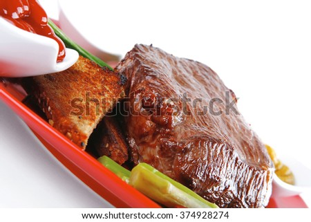 grilled beef with toasted bread on red dish - stock photo