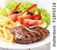 Grilled beefsteak with french fries - stock photo