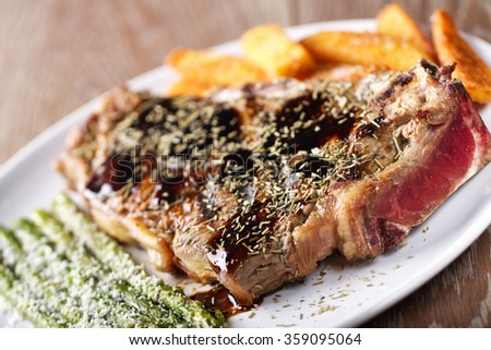 Grilled beefsteak with french fries and asparagus