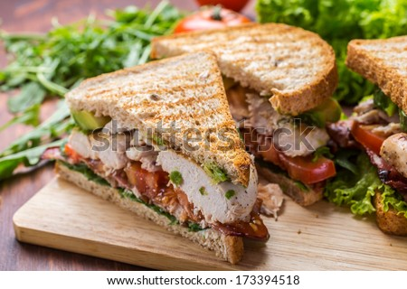 Grilled BLT Bacon, Lettuce and Tomato  Sandwiches with Chicken and Avocado - stock photo