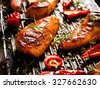 Grilled breast of chicken in spicy marinade with the addition of chili - stock photo