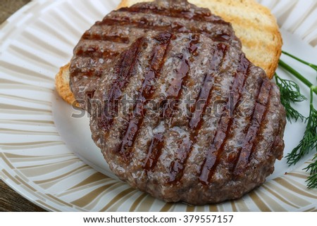 Grilled burger cutlet beef minced meat on wood background