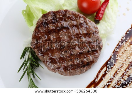 Grilled burger cutlet with rosemary and salad leaves