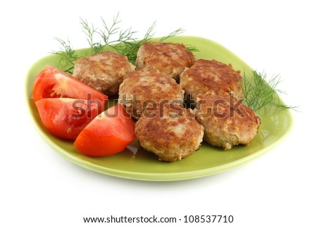 Grilled burgers on the green plate isolated on a white background