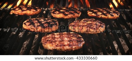 Grilled Burgers On The Hot Flaming Charcoal Grill, Top View.  - stock photo