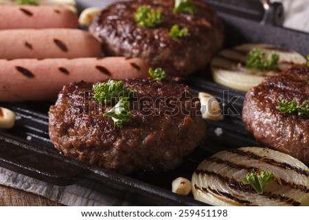 grilled burgers with vegetables in a pan grill closeup. horizontal