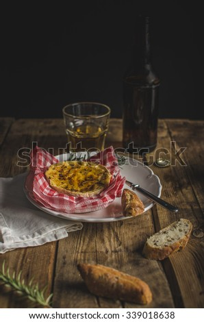 Grilled camembert with herbs and garlic, czech delicious beer, dark photo, ready for you text, advertising, old school photo